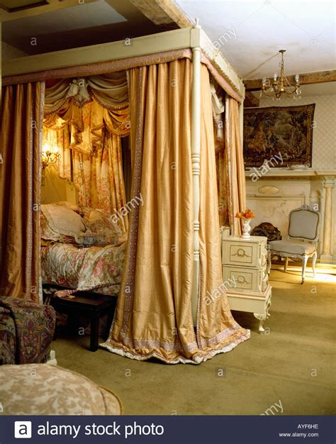 Four Poster Bed Curtains Drapes Four Poster Bed With Silk Curtains And Integral Lighting Stock Photo Royalty Free Image
