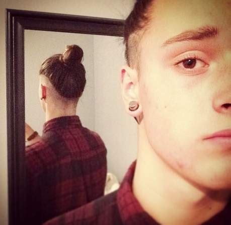 new man bun hairstyle trend the low undercut man bun