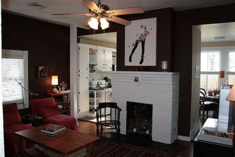black wall paint with picture also white fireplace and sofa f chair feat rectangle brown