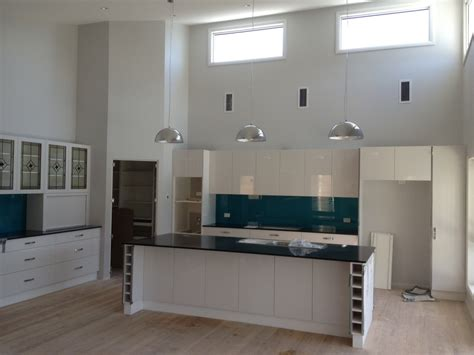 galley style kitchen with raked ceilings and hi lite