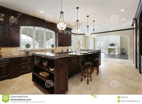 Kitchen With Dark Wood Cabinetry Stock Photo   Image: 12656176