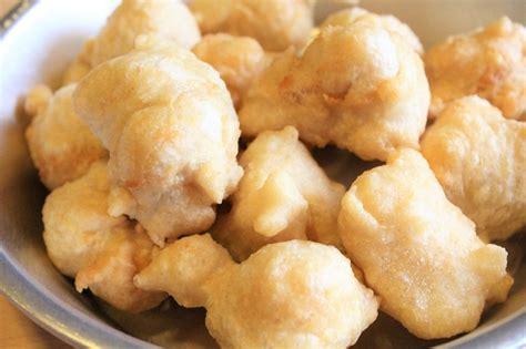 come si fanno le frittelle di fiori di zucca zeppole di pasta cresciuta la ricetta delle frittelle