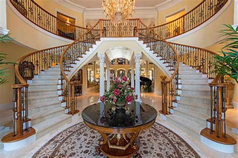 mansion foyer beautiful sweeping staircases make for a grand