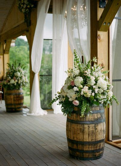 rustic flower arrangements on purple carnations sunflower floral arrangements and