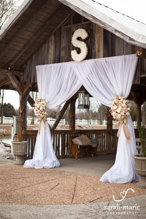 outdoor wedding draping draped wedding ceremony at legacy farms flowers by