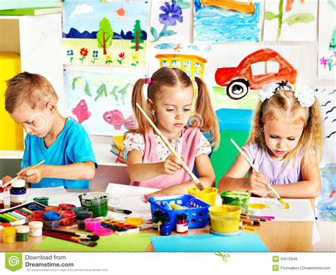children s painting child painting at easel royalty free stock photo image