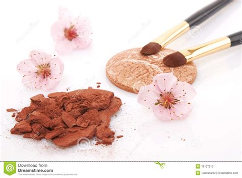 brown powder for makeup and flowers stock photo image