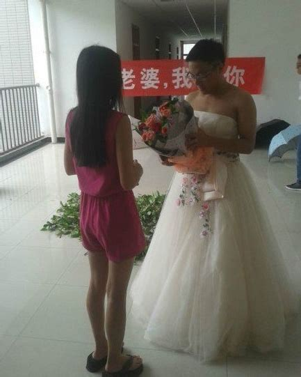 role reversed wedding chinese groom dresses as bride for wedding rehearsal
