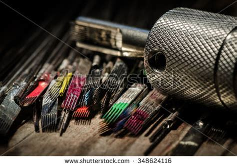 tattoo needle not holding ink closeup used tattoo needles covered colorful stock photo