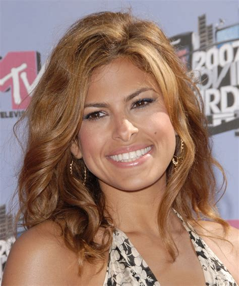 eva mendes casual long wavy hairstyle light golden