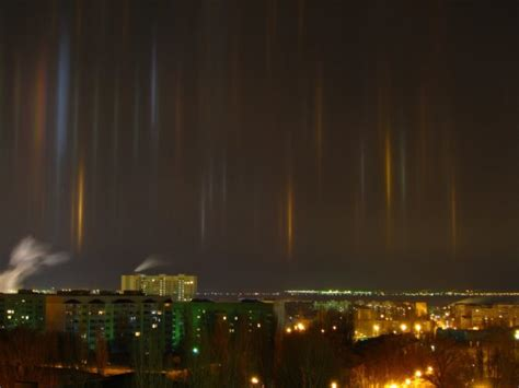 light pillars angels are descending to earth through eerie light pillars