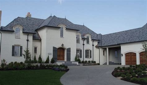 french chateau style home in stucco cast stone the enchanted home
