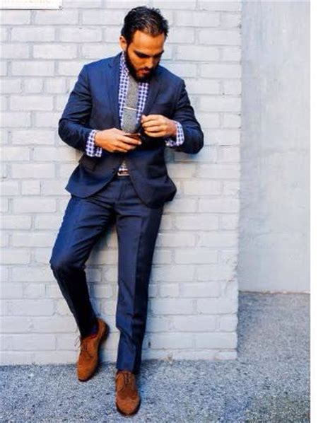 blue suit purple gingham shirt grey tie and brown suede