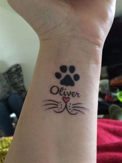 tattoo cat on wrist 22 small cat tattoo ideas for ladies styleoholic