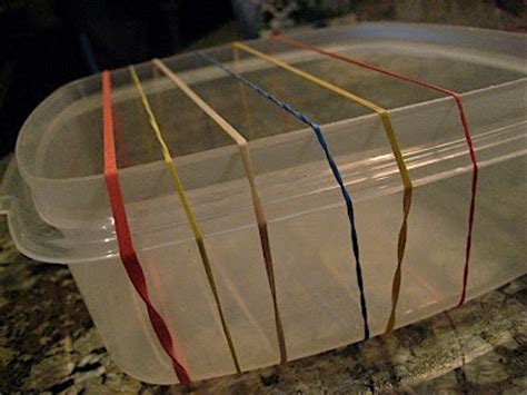 Handmade Instruments - rubber band guitar made from tupperware elastic bands