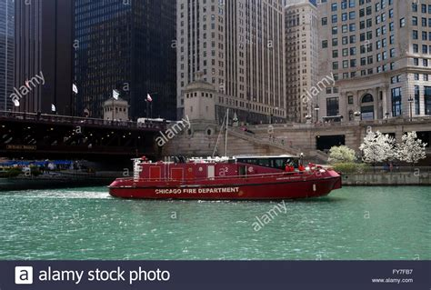 pedal boat on chicago river chicago river michigan avenue bridge stock photos
