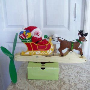 whirlygig mechanical santa sleigh with reindeer christmas