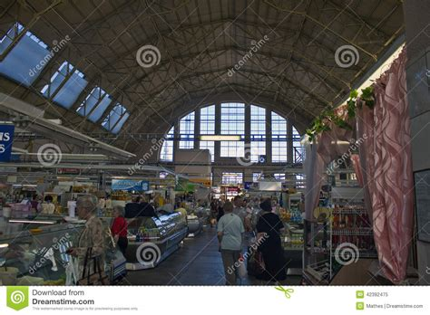 people shop at central food market in riga editorial image