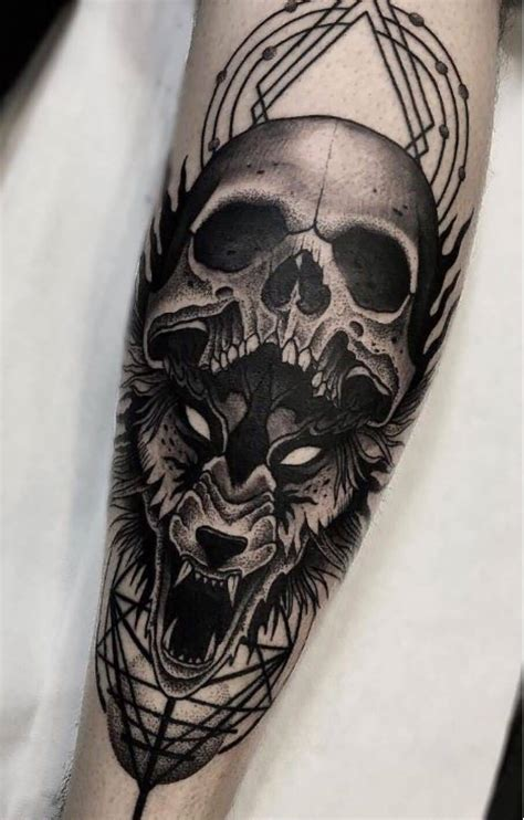 wolf and skull tattoo on forearm