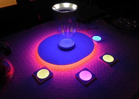 light up your drinks with these led coasters brit co
