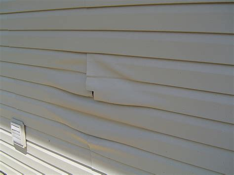do it yourself siding a house vinyl siding repair 7 easy do it yourself steps