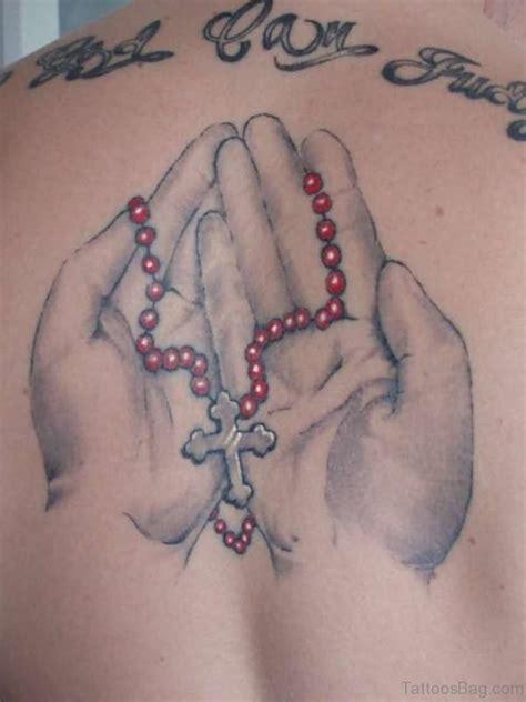 77 elegant praying hands tattoos on back