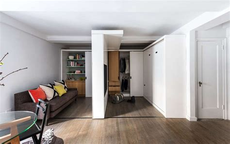 movable walls for apartments small apartment utilizes a sliding wall to hide its functions
