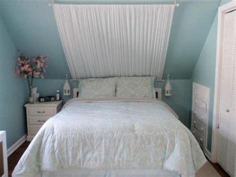 Sloped Ceiling Bedroom Decorating Ideas by Sloped Ceiling Bedroom With Curtain Sloped Ceiling