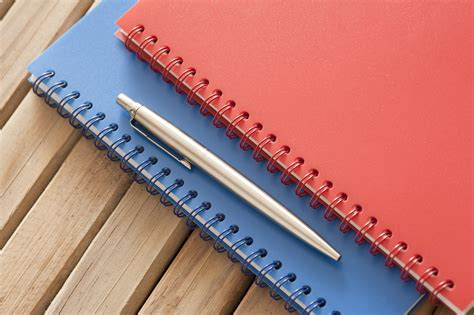 Notebook Wooden Table image of ballpoint pen and spiral notebook on wooden table
