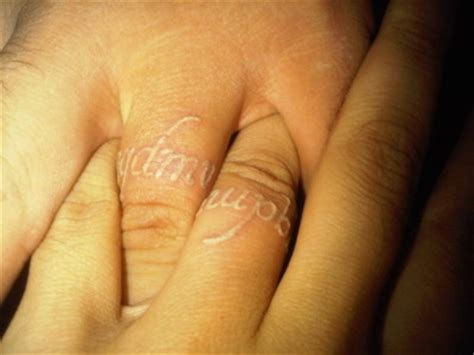 matching white ink ring finger tattoos que quieres de mi