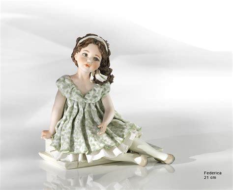 little girl sitting on bench statue sculpture depicting little girl sitting federica