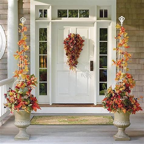 falling leaves topiary in urn arrangement traditional