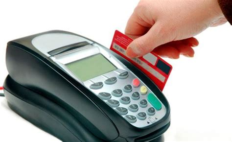 debit card machine feds and retailers both want swipe card fee in place