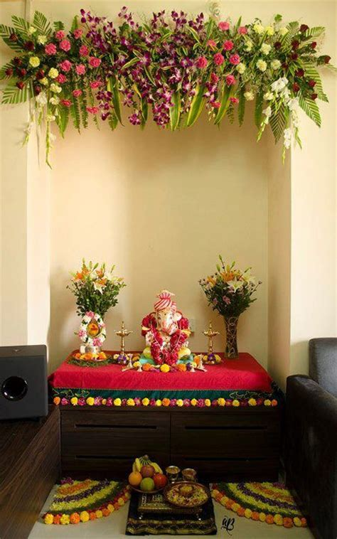 flowers decoration in home devotees welcome lord ganesh to their home during the