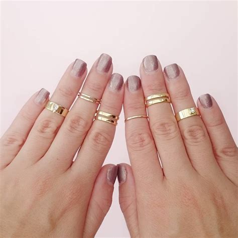 gold midi ring set of seven by staxx notonthehighstreet com