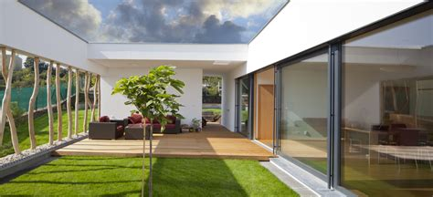 Alfresco Home Patio Furniture Tranquil Grassed In Courtyard In The Middle Of A Modern
