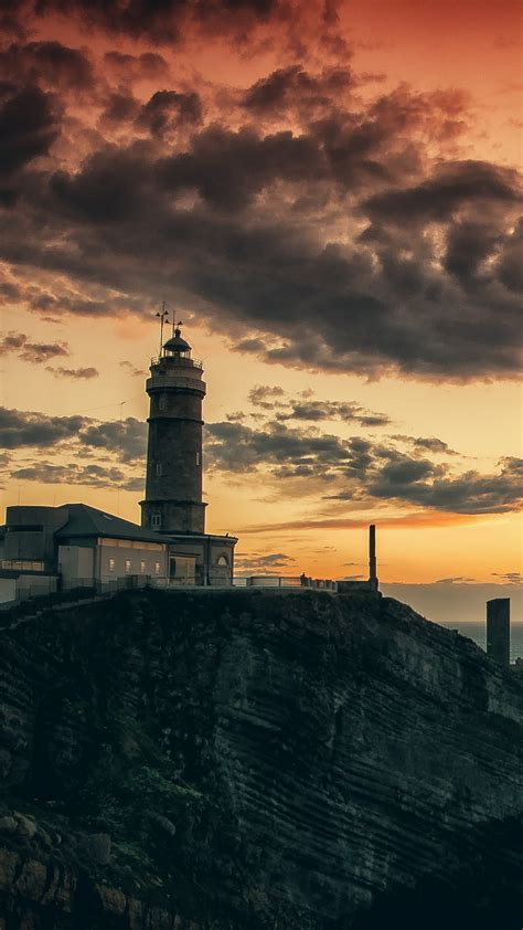 wallpaper lighthouse hd  wallpaper rocks sea sunset