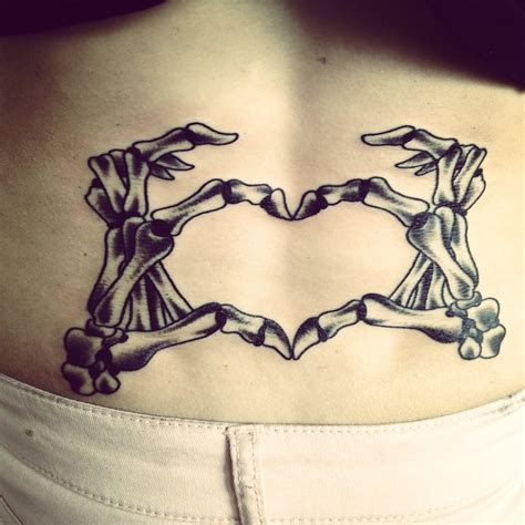 hand heart tattoo designs lower back shaped skeleton that