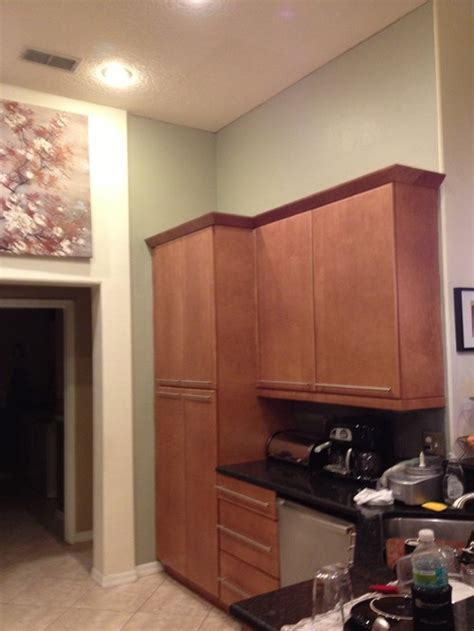 what to put above kitchen cabinets what to put above kitchen cabinets in a tall kitchen