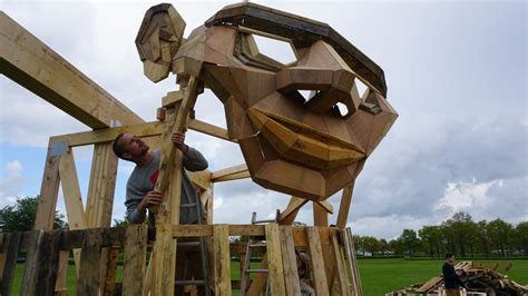 thomas dambo creates recycled wood sculpture called