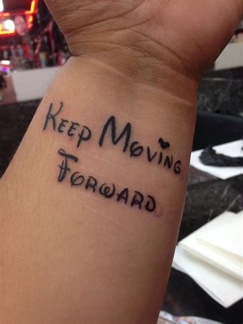 moving tattoos keep moving forward disney tattoos