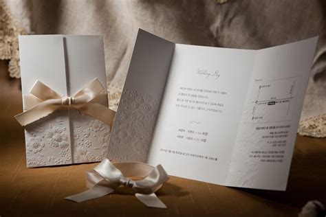 vintage embossed tri fold wedding invitation with ribbon bow set of 50wedding favors casual