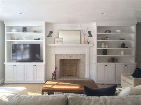 living room family room tv room fireplace built ins shiplap modern sconces jute rug