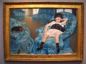 in a blue armchair by cassatt a photo