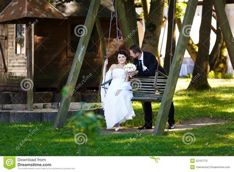 crystal swing happy days happy bride and groom stock photo image 52197770