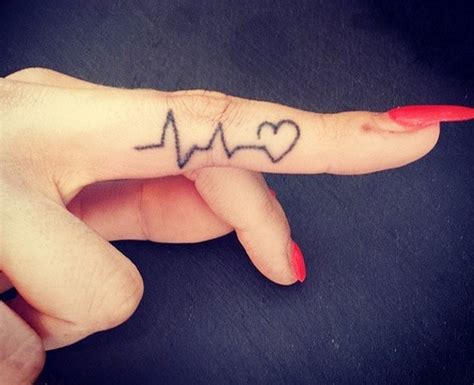 joy tattoo on finger 30 finger tattoos you would love to flaunt