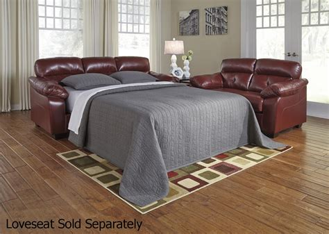red leather couches ashley furniture benchcraft by ashley bastrop 4460236 red leather sofa bed