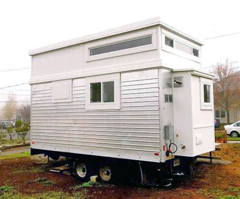 transforms a salvaged trailer into an tiny
