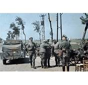 On The Outskirts Of Dunkirk German Officers Confer By Their Vehicles