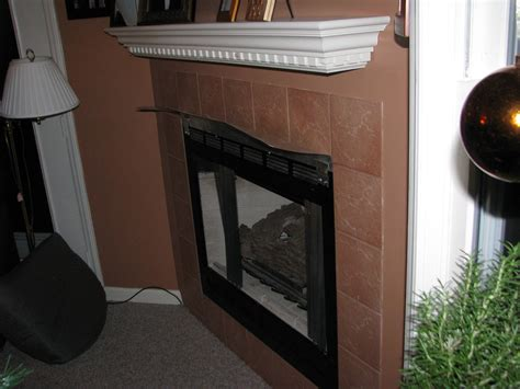 tv fireplace heat shield how can i prevent the mantel above a gas fireplace from